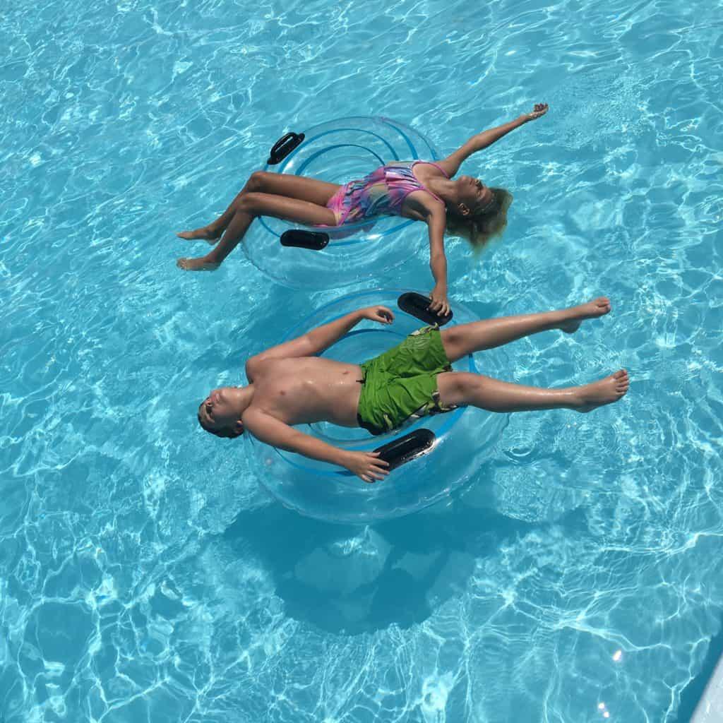 kids relaxing in pool