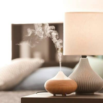 diffuser and lamp on table
