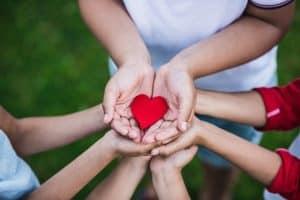 kids holding a heart