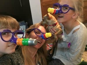 family plays board game fibber