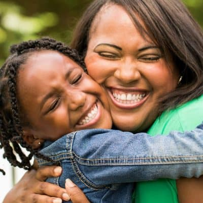 mom and girl hugging