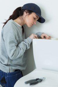 single mom fixing a toilet
